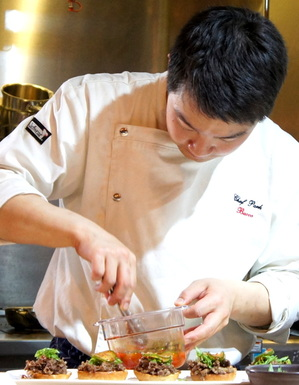 Chan's Chef Park assembles bulgogi sliders.JPG